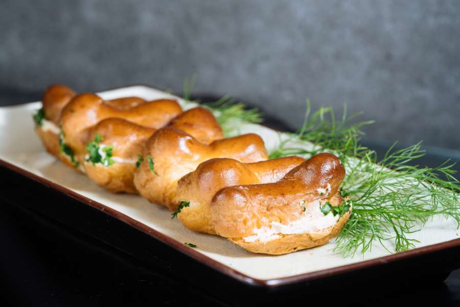 Choux pastry buns with zesty salmon and dill cream