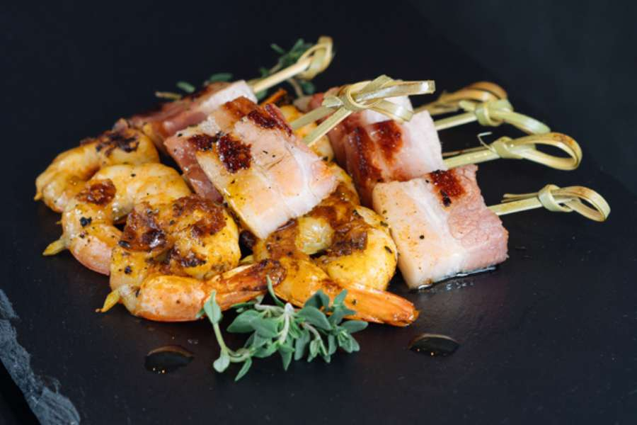 Prawn dusted with paprika and pancetta skewer