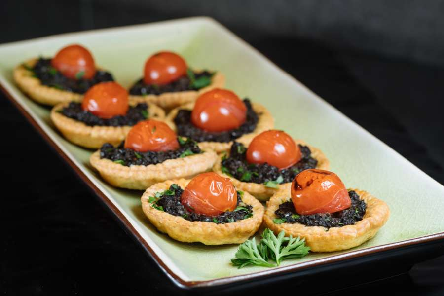 Thyme scented olive crush with roasted cherry tomato tartlets