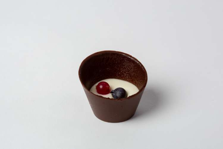 Chocolate cups with white chocolate mousse and forest fruit -  Elia Caterers