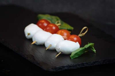 Caprese skewers drizzled with a basil infused olive oil - Elia Caterers